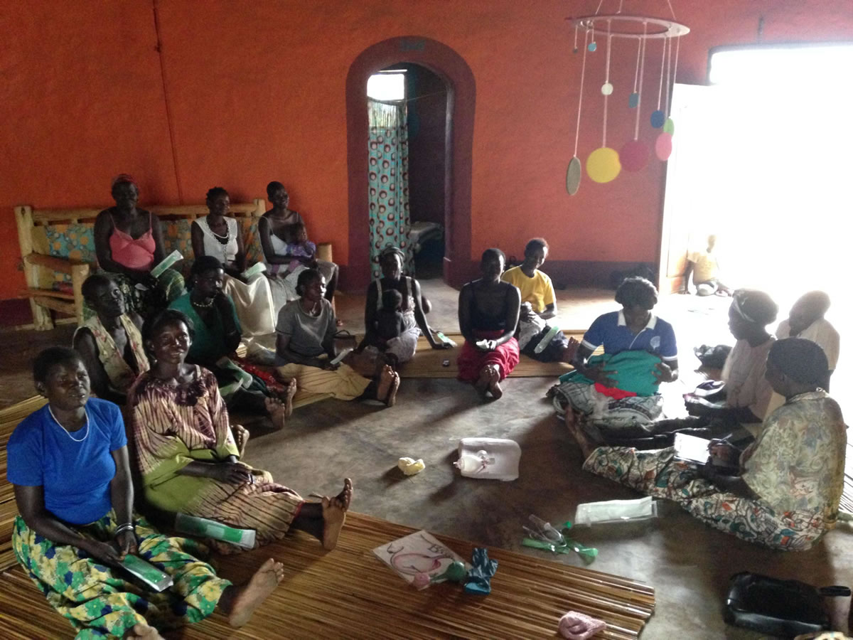Birth house in Ugandan village with group of women